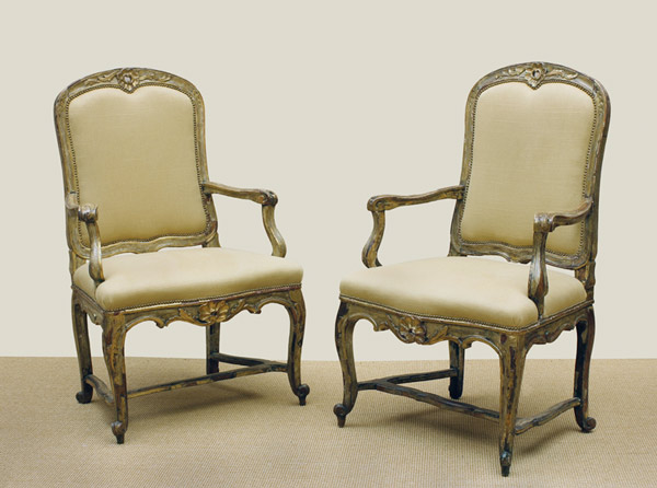 Pair of Italian Rococo Period Cream Painted and Gilt Armchairs