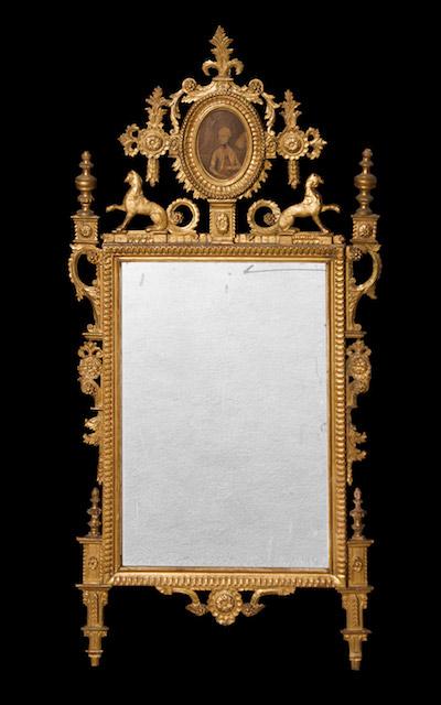 A Fine Italian Neoclassic Giltwood Mirror